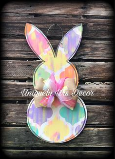 Please attach a note to seller with the initial if you would like to have personalization on the door hanger. This door hanger is hand painted with acrylic paint, wired to hang straight out of the box & finished off with a lush accent bow. Its cut from 1/4 wood. This door hanger is