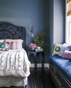 Create a calming bedroom with teal and lavender colors.