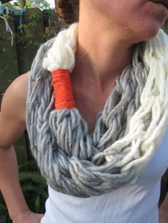 Like the style. Would replace red thing with leather or something like that.    Very soft arm knitted infinity scarf  Gray and cream by SoulPanda, $28.00