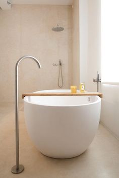 Simple luxury. The simple, elegant shapes of the bath and fixtures allows the textures to shine.