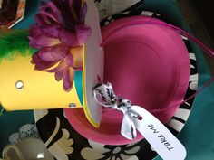 """Have some """"mad hatter"""" hats avaiable for guests or even put on the invatation """"Bring your best Mad Hatter Hat"""" Possible contest for a great prize? -kw"""