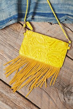 Tooled Wallet | Beautifully tooled leather crossbody featuring suede fringe accents.