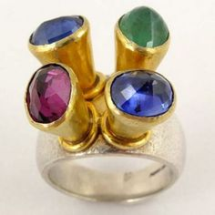 Four Stone Ring 29 One-off ring with silver band and emerald, sapphires and garnet set in gold detail. Poppy Dandiya