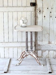 Shabby Chic Table / 5 Days Of White Furniture.  The table is white with e the detailed areas heavily distressed. Staged with large sea shells gathered on Kodiak Island..