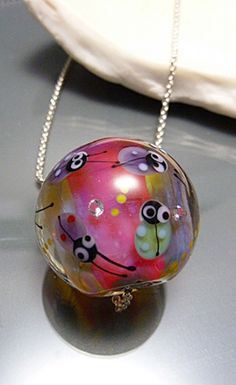 Ladybug glass focal, handblown glass bead with sterling silver core. Suitable for many different chains. Available here https://www.etsy.com/listing/201917535/pink-ladybug-pendant-lampwork-bead-hand?ref=shop_home_active_9