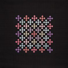 Nines on Point. The colors shimmer on the black background. Have always been fascinated by the color play of Amish quilts