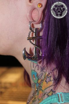 http://www.tulsabodyjewelry.com/collections/earrings-and-studs/products/anchor-tunnel-hoop-earrings