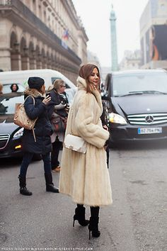 Christine Centenera in a white fur, the Chanel boy over the all black look. Source: carolinesmode.