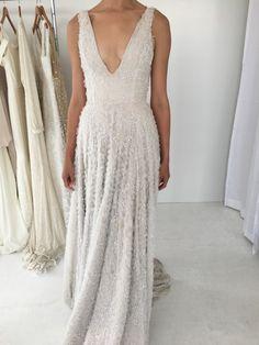 Ivory embellished plunging neckline wedding dress: http://www.stylemepretty.com/2016/10/18/lovely-bride-lanie-list-bridal-market/ Photography: Lovely Bride - http://lovelybride.com/