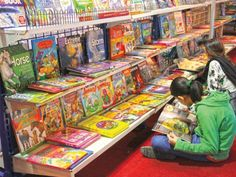 A girl reads a book at the Karachi International Book Fair 2012, a five-day event organised by the Pakistan Publishers' and Booksellers' Association. Children turned out in large numbers on the opening day. PHOTO: AYESHA MIR/EXPRESS