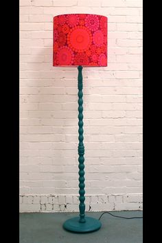 An upcycled vintage wooden standard lamp, painted, with 'funky' shade