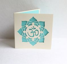Paper cut Aum and Lotus Greetings Card