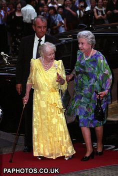 Queen Elizabeth arrives with the Queen Mother for the latter's birthday visit to see The Importance of Being Earnest at the Theatre Royal, London, 1999