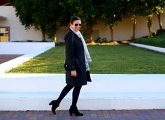 Sherine Youssef, Acting Beauty Director David Lawrence trench coat, Gap sweater, J.Crew skirt, Aldo boots, Chanel bag, Marc by Marc Jacobs watch, Ray Ban sunglasses.