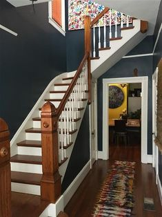 This dark Hague Blue hallway looks modern and clean, all while making a wonderful statement Dark Staircase, Staircase Design, House Stairs, Carpet Stairs, Dark Blue Hallway, Farrow And Ball Living Room, Hallway Inspiration, Hallway Ideas, Houses