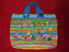 Recycled hand knitted bag made of plastic bags, with knitted handles and vintage button trim