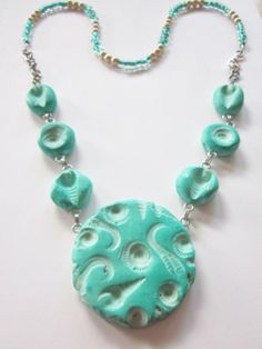 Mermaids RockTurquoise Faux Ceramic Polymer Clay Fossil Necklace by blessen, $34.00 Check out The Polymer Arts Magazine to see one of my necklaces!(2014-Spring)