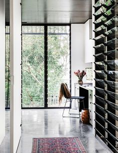 A study nook is set in a corner between two banks of full-length louvre windows. **chair** from [Janie Collins… Australian Homes, Modern House Design, Space Design, Home, Louvre Windows, Pod House, Interior Inspo, Louver Windows, Retro Interior