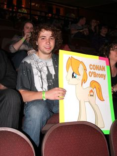 Dylan with his art at the Conan O'Brien Show