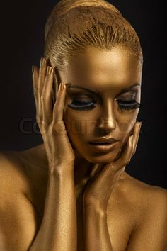 Image of 'Face Art. Fantastic Gold Make Up. Stylized Colored Woman's Body' on Colourbox