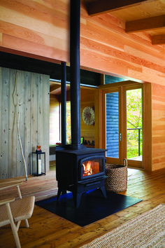 The wood burning stove and the breezeway - By arriz + co. and Suzanne Dimma Photography: Michael Graydon