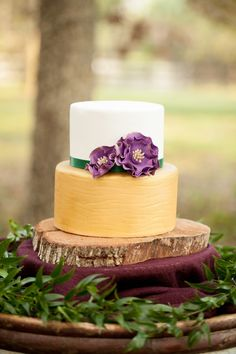 Rustic Chic Purple and Gold Cake // photo by http://bumbyphotography.com, via http://theeverylastdetail.com/rustic-chic-champagne-purple-wedding-inspiration