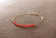 matte coral czech beads strung on 14k gold-filled chain