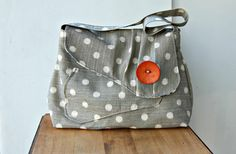 Hey, I found this really awesome Etsy listing at http://www.etsy.com/listing/121706281/vintage-inspired-gray-polka-dot-handbag