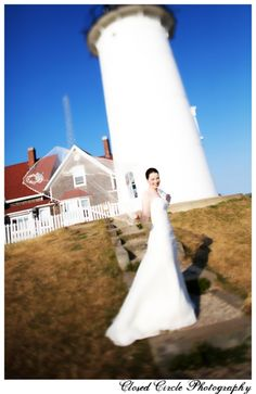 Bride at a lighthouse, cape cod wedding.