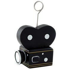 This Movie Camera Photo or Balloon Holder will be the perfect addition to your Hollywood Party. Each holder measures 2.75 inches tall by 2.5 inches wide and weighs 6 ounces. Each photo or balloon hold