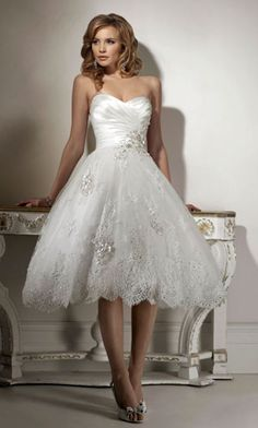 I don't usually like short wedding dresses but if I were to have one this would probably be it....super cute