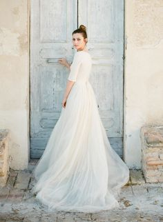 Modest 3/4 sleeve wedding gown. Photography: Greg Finck - www.gregfinck.com Wedding Dress: Cortana - www.cortana.es Read More on SMP: http://www.stylemepretty.com/2015/09/14/romantic-italian-villa-wedding-inspiration-2/