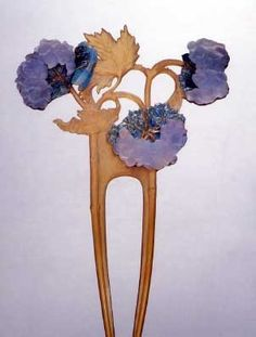 Hortensia comb by Rene Lalique(?). So far, I've been unable to locate a source...