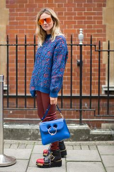 Get All the Outfit Inspiration You Need From the Style Set at London Fashion Week Day 2 J.W. Anderson bag.