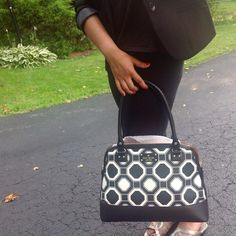 Super cute Kate Spade bag. Cute black/white large bag by Kate Spade, fits everything with ease and elegance. Although this has been sitting in my closet for months --please note -- bottom leather leather portion has discoloration; which is shown in pic #3. Please no trades. **cover shot courtesy of Google and Pintrest. kate spade Bags Totes