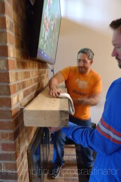 Installing a floating mantel on a brick fireplace. (the ambitious procrastinator: Dead Trees Can Be Festive.) for my mom's house Fireplace Update, Home Fireplace, Fireplace Remodel, Fireplace Design, Fireplaces, Brick Fireplace Decor, Fireplace Makeovers, Fireplace Ideas, Floating Mantle