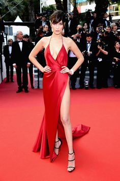 Bella Hadid completely stole the show when she hit the red carpet in Cannes for The Unknown Girl (La Fille Inconnue) premiere wearing a dangerously revealing red Alexandre Vauthier gown. It looked like she had artfully, yet effortlessly, swathed herself in a wisp of silky red satin, making sure to cover only the most necessary bits before heading out—and I say that with the highest of praise.