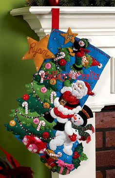 All your favorite Christmas characters are working together to put The Finishing Touch on their Christmas Tree. Frosty is boosting Santa up as Santa raises up one of the elves who is holding up a little penguin so the penguin can place the star on top of the beautifully decorated tree. | eBay!