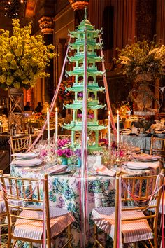Stunning Chinoiserie vignette was that of Dennis Rolland, whose Imperial Garden Fête stood out with its majestic tole pagoda by Two Worlds Arts and exuberant pastel colors.
