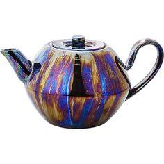 Shop Oil Slick Shiny Grey Teapot. Classic teapot shape meets futuristic new finish. An iridescent reactive glaze coats dark grey stoneware, leaving shiny, luster effect we can't resist. A fun take on tea time.