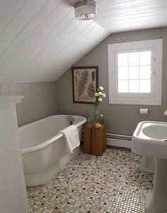Small attic bathrooms with slanted rooves.