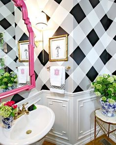 Such a fun bathroom! Love the checkered black and white wall paper with the pop of hot pink in the mirror! Great inspiration for a girls bathroom!