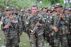 Moro Islamic Liberation Front (MILF) rebels attend a rally in support of the peace agreement with th... - Fournis par AFP