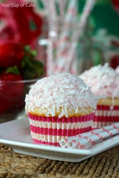 Strawberry Coconut Cupcakes~T~ A coconut cake with a Strawberry Buttercream, two of my favorite flavors in one cupcake.