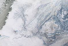 River Delta.  The Yukon River branches into thousands of distributary channels as it drains into the Bering Sea off the coast of Alaska. The river is flowing right to left in the image, with the Bering Sea visible in the far left side of the image.