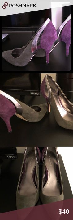 Like New Condition - Suede Calvin Klein Heels sz 7 Worn once, pristine condition, only light use showing on the souls as shown in last 2 photos. The white line on the heel in the cover photo is a string that I didn't notice until after photo was taken. Size 7, heel is about 3 inches. Violet, Gray with a light touch of metallic silver detailed cutout. Calvin Klein Shoes Heels