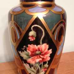 Back side of luster and gold china painted vase