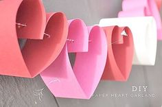 DIY Heart Garland, step by step directions, think of place to do this other than just for Valetines. Maybe a little girls room, etc paper DIY: Paper Heart Garland Valentines Day Decorations, Valentine Day Crafts, Be My Valentine, Holiday Crafts, Heart Decorations, Holiday Decor, Holiday Ideas, Saint Valentin Diy, Valentin Nap