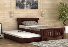 Kendra Trundle Bed in walnut finish is an amazing bed to serve as an extra bedding and is great for the kids too. This bed made up with is robust and thus prove to be long lasting, reflecting its beautiful design and style. Get pull out online in India at Bedroom Furniture Design, Find Furniture, Awesome Bedrooms, Beautiful Bedrooms, Wooden Trundle Bed, Single Beds With Storage, Dinning Table Design, Bedroom Colors, Bedroom Ideas