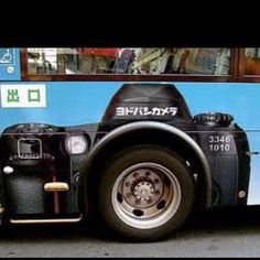 Camera ad on side of bus in Japan... Clever